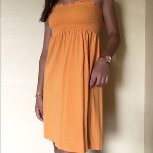 Orange strapless mini dress